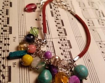 Multicolored dangle and suede bracelet