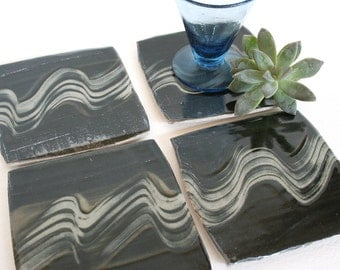 Set of four stoneware coasters with squiggly patter in black and white. Brush strokes, rustic, graphic pattern, folk art pattern, expressive