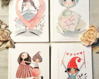 set of four greetings cards and envelopes