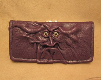Grichels leather ladies wallet - scaly plum purple with green star eyes