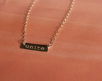 Silver UNITE necklace to support the ACLU