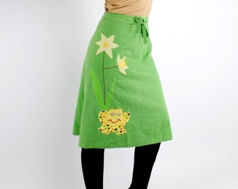 Vintage 70's novelty wrap skirt, green with adorable patchwork frog applique, button eyes, reverses to green with white polka dots.