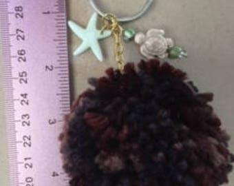 brown yarn pom pom keychain