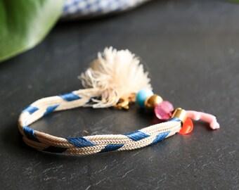 Delicate handwoven silk tassel bracelet vintage glass brass beads