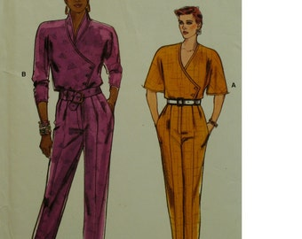 Tapered Jumpsuit Pattern, Asymmetrical Side Closing, Long/Elbow Sleeves. Stand-up Collar, V-neck, Belt, Pockets, Vogue No. 9479 Size 12 14