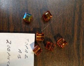 8mm Swarovski Crystal Cube topaz AB