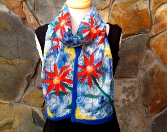 Orange and yellow flower design on blue dyed silk, nuno felt scarf
