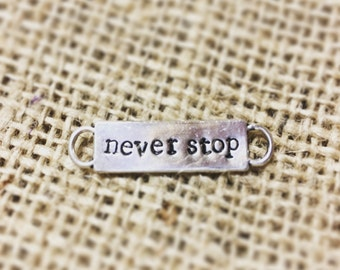 Never Stop Shoe Charm