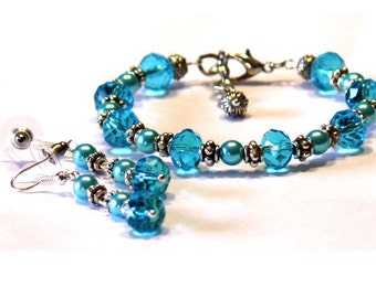 Faceted Crystal Rondelles Bracelet with matching Earrings in Turquoise and Baby blue