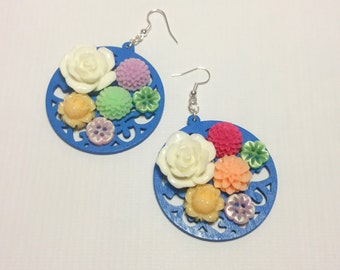 A bouquet of flowers on blue wood ornament. Earrings , christmas gift ready to ship!