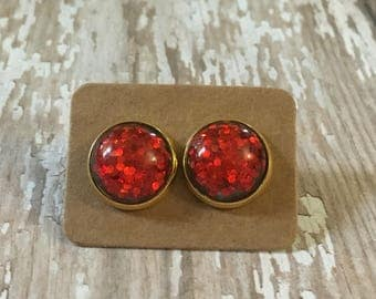 Nickel free!  Ruby red glitter studs