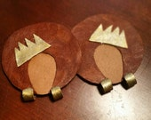 """Leather """"afro ladies"""" earrings with painted gold and glitter crown and matching hoop earrings."""