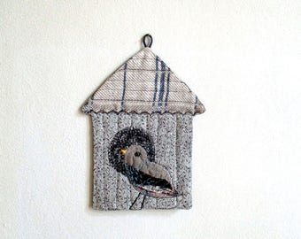 Mini birdhouse in grey wall decor for bird lovers