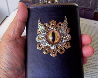 Dragon Eye Emblem Flask (F606) 8 ounce, Black Leather, Hand Painted Glass Eye, Brass Stamping, Silver Wings, Swarovski Crystals