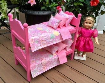 American Girl Doll:  Furniture, hot pink  bunk beds, with  12 piece multi colored pink bedding