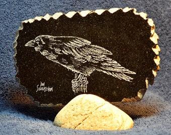 Raven hand etched on black granite tile