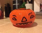 Glass jack-o-lantern pumpkin