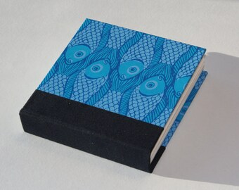 Square hardback  sketchbook, notebook or journal, hand stitched and bound in blue fish hand silkscreen printed design.blank white cartridge