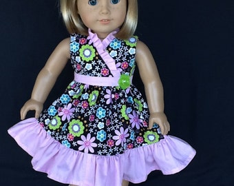 18 inch doll wrap dress. Fits American Girl dolls. Black floral print with pink contrast.