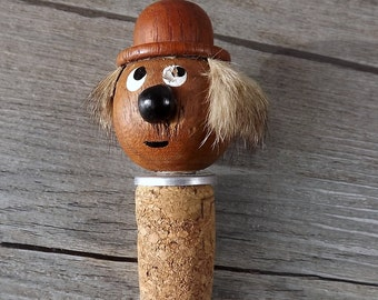 Vintage wooden bottle stopper, wearing top hat