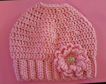 Pink sparkle yarn crochet messy bun hat with flower, one size fits teens and women