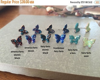 70% OFF frostbitten FAIRY FARTS butterfly studs hand painted blue with lots of glitter << these nymphs also donate to Humane Society