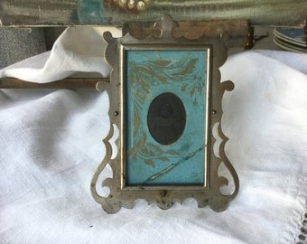 French vintage frame for picture in metal 19th with ferrotype representing a little girl