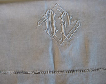 French linen sheet with ladderwork return and monogram ME