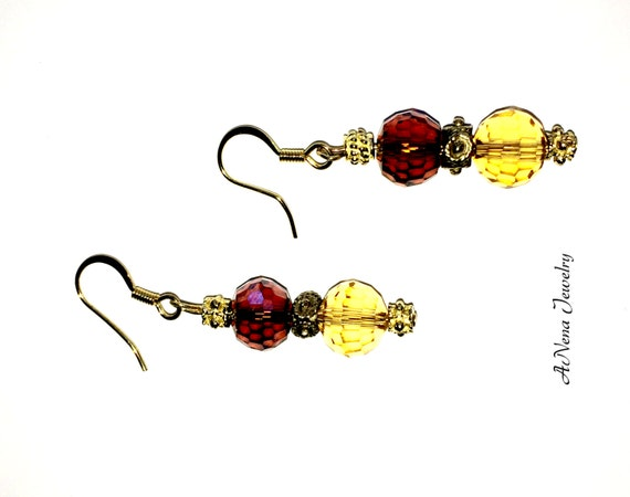 Amber Magic Earrings: Amber Brown and yellow  faceted Crystal rounds, Gold Toned Spacers dangle By ANena Jewelry