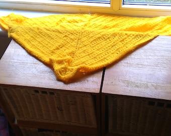 Small hand knitted triangular shawl