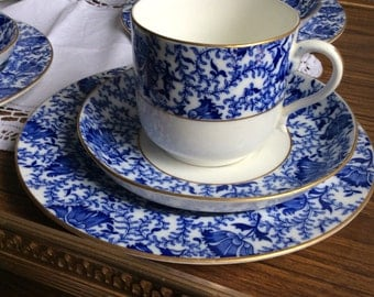 Antique blue and white china tea cup trio
