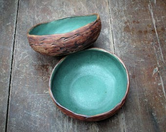 Pair of hand coiled stoneware bowls.  Turquoise, copper patina glaze. Set of 2.