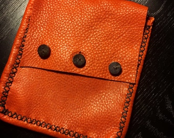 Hand made elk hide belt pouch.