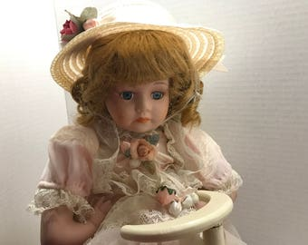 Vintage Porcelain Doll on Wood Bike