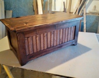 red mohogany 40 / 16/ 18 solid pine chest with two devider inside