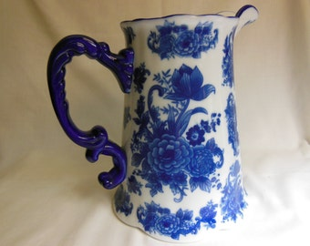 Vintage Blue & White Water Milk Pitcher w/Blue Flowers Beautiful White Pitcher w/Blue Flowers offers considered