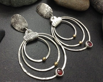 Deep red garnet statement earrings,  three large hanging hoops, hammered round sterling silver circles, brass balls, bezel set stones