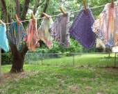 A dozen random knit dishcloths