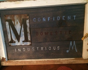 "Letter ""M"" and its meanings on reused wood and old windowframe"