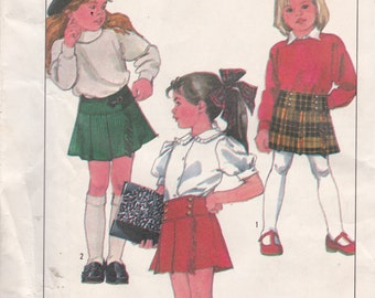Simplicity 8765 Vintage Pattern Little Girls Front Wrap Pleated Skirt in 2 Variations Size 3,4,5 UNCUT