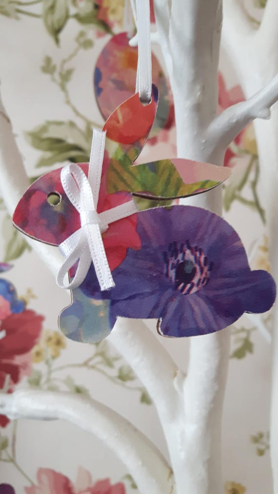 Easter bunnies and eggs. Floral decoupaged hanging wooden Easter bunnies and Easter eggs.  Twig trees.  Easter decorations.