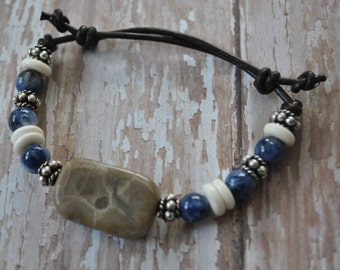 Petoskey Stone Bracelet on leather with blue Sodalite stone beads, sterling silver beads, Up North, bracelet, Michigan