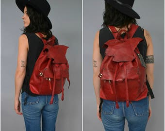 HANDMADE red leather drawstring backpack with vintage trim and recycled leather