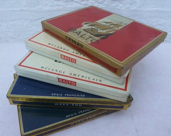 Instant collection vintage tins boxs 1960s table accessory French collectors cigarette tins interior design coffee table tin 60s gift rustic