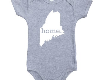 Homeland Tees Maine Home Unisex Baby Bodysuit