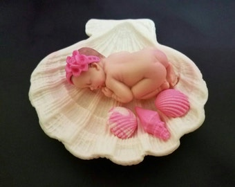 Fondant baby laying on a  Clam Sea shell cake topper for Baby Shower, Birthday, Party Favor