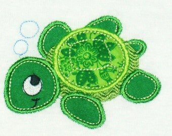 Unisex Sea turtle applique available on an infant body suit, toddler shirt, bib or burp cloth.