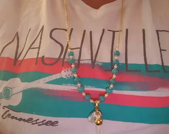 Chain and turqouise bead necklace with tassle