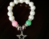 """Arm Candy. """"The Silver Star"""" AKA inspired charm/beaded bracelet . Pink and Green. Alpha Kappa Alpha"""