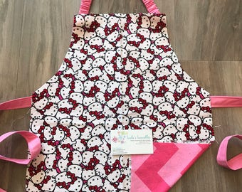 Kitty toddler apron, personalized, made from licensed hello kitty fabric.